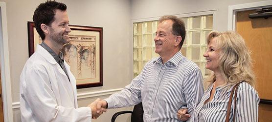 Chiropractor Winter Park FL Matthew Rumley Meeting Patient